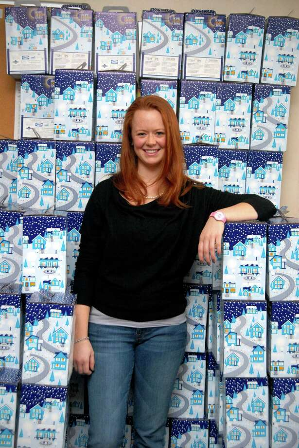 Aleksa Lazarewicz, special events manager at the Family Centers in Greenwich, Conn.,  stands with luminaries on Friday December 7, 2012 that are being sold in support of Family Centers' annual Hope Lights Lives fundraiser. Photo: Dru Nadler / Stamford Advocate Freelance