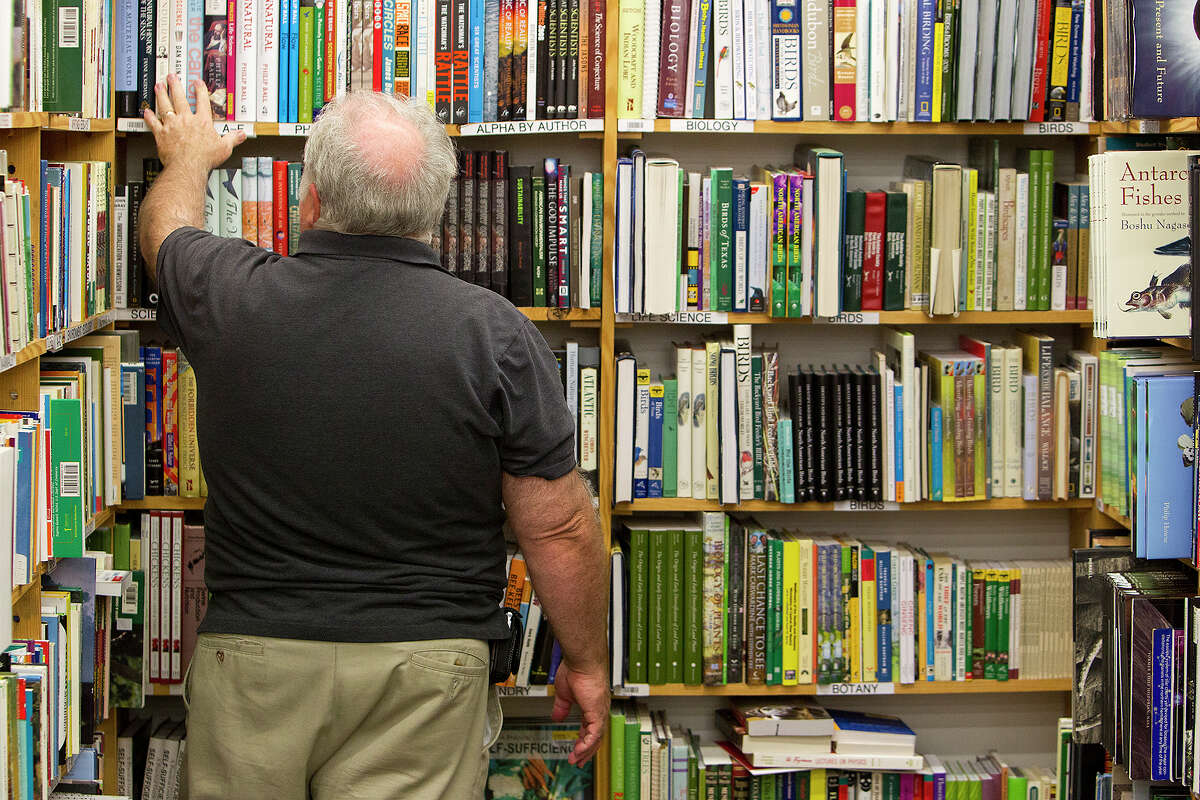 Harry Noyse shops for books at Half Price Books at Stone Ridge Market on Monday, Dec. 3, 2012. Noyse said he had been shopping at Half Price Books since the mid-1970s.