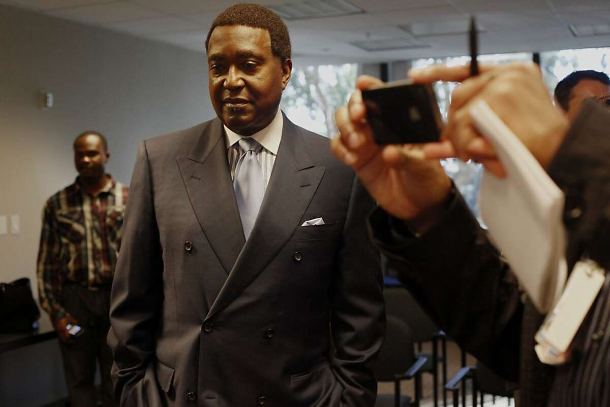 Civil Rights attorney John Burris watches the video tape with the media, Wednesday Dec. 12, 2012, in Oakland, Calif. One day after authorities cleared an officer in the fatal shooting of Ernesto Duenez Jr., family members released a video of the incident and called for the officer to be prosecuted for murder.