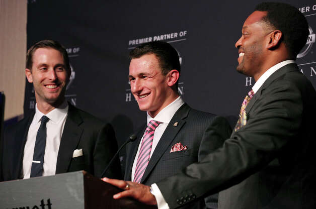 Texas A&M's offensive coordinator and quarterbacks coach Kliff Kingsbury (from left), Texas A&M's quarterback Johnny Manziel, the 2012 Heisman Trophy winner, and Texas A&M's headcoach Kevin Sumlin answer questions from the media during a press conference Saturday Dec. 8, 2012 at the New York Marriott Marquis hotel in New York, New York. Photo: Edward A. Ornelas, San Antonio Express-News / © 2012 San Antonio Express-News