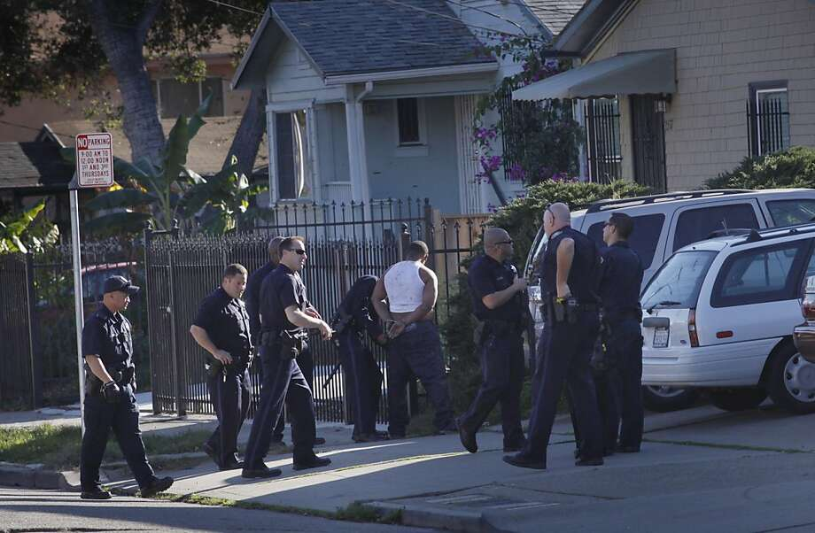 Police apprehend a robbery suspect Monday at 35th Avenue and Quigley Street in Oakland. The city has fewer police but faces strict guidelines on data collection in making police stops. Photo: Lacy Atkins, The Chronicle
