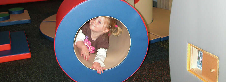 Numerous museums around the state are offering special programs for children during the upcoming school vacation. Above, a youngster explores an exhibit at The Discovery Museum in Bridgeport. Photo: Contributed Photo