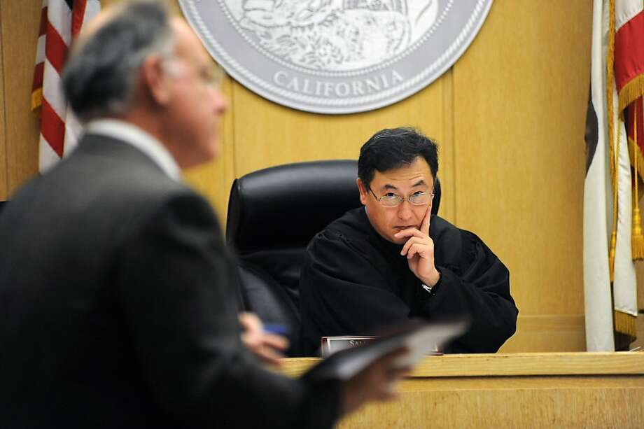 Judge Samuel K. Feng( R) listens to a statement from lawyer Harry Dorfman representing the prosecution.   An arraignment of five suspects held in connection with the slaying of a man found gagged and bound in Visitation Valley was held at the was held at the Hall of Justice at 850 Bryant St. in San Francisco, Ca Wednesday December 12th, 2012. Photo: Michael Short, Special To The Chronicle