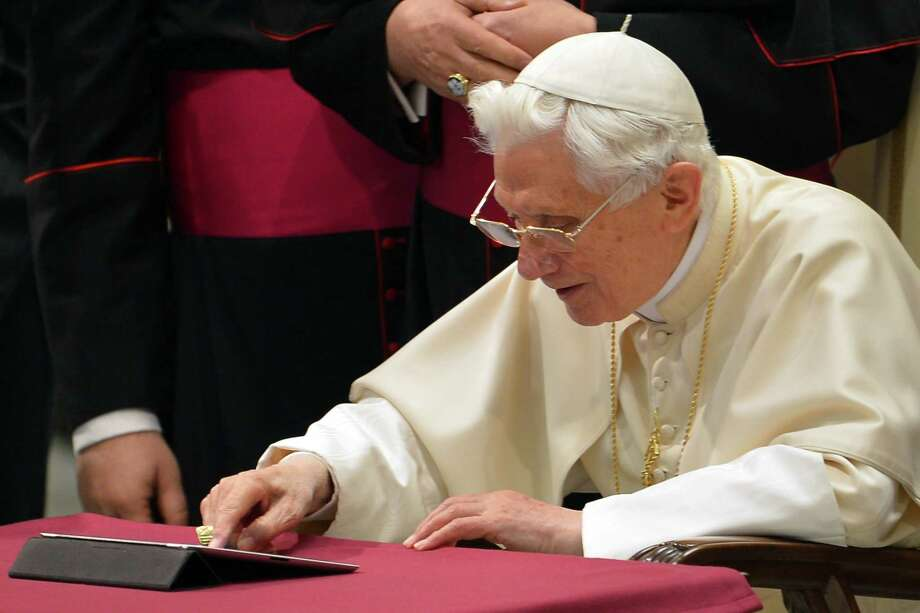 Pope Benedict XVI clicks on a tablet to send his first twitter message during his weekly general audience on Wednesday at the Paul VI hall at the Vatican. Photo: VINCENZO PINTO, Staff / AFP