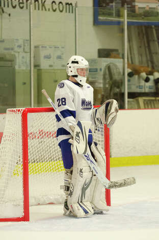 Darien's goalie Michael Collins (28) during the boys ice hockey game against Hamden High School at the Darien Ice Rink on Wednesday, Dec. 12, 2012. Photo: Amy Mortensen / Connecticut Post Freelance
