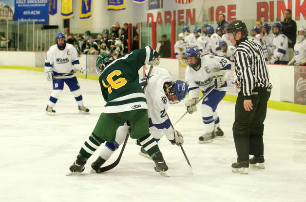 Darien's Brendan Hathaway (21) battles Hamden's Tyler Carangelo (16) during the boys ice hockey game against Hamden High School at the Darien Ice Rink on Wednesday, Dec. 12, 2012. Photo: Amy Mortensen / Connecticut Post Freelance