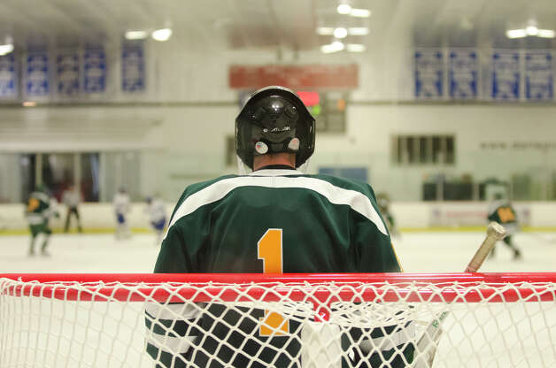 Hamden's goalie Matt Hoff (1) during the boys ice hockey game against Darien High School at the Darien Ice Rink on Wednesday, Dec. 12, 2012. Photo: Amy Mortensen / Connecticut Post Freelance