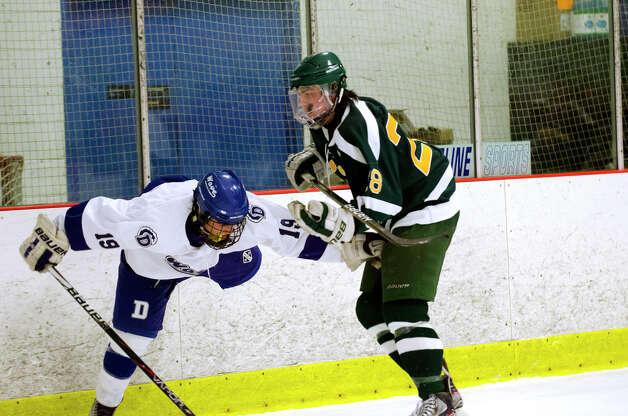 Darien's Robbie Juterbock (19) gets tangled up with Hamden's Joe O'Connor (28) during the boys ice hockey game against Hamden High School at the Darien Ice Rink on Wednesday, Dec. 12, 2012. Photo: Amy Mortensen / Connecticut Post Freelance