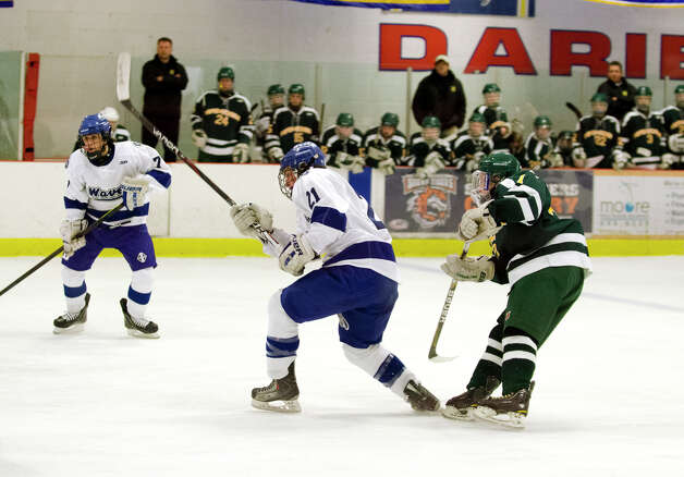 Darien's Brendan Hathaway (21) takes a shot on goal during the boys ice hockey game against Hamden High School at the Darien Ice Rink on Wednesday, Dec. 12, 2012. Photo: Amy Mortensen / Connecticut Post Freelance