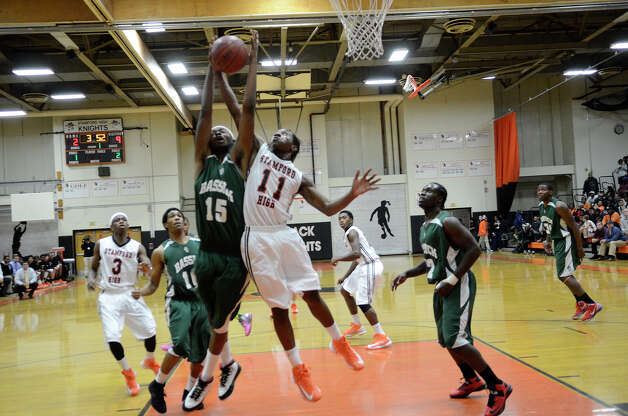 Stamford #11 Jelani Tonge and Bassick #15 D. J. Young head for the basket as Stamford High School hosts Bassick High School in boys varsity basketball in Stamford, CT on Dec. 12, 2012. Photo: Shelley Cryan / Shelley Cryan for the Stamford Advocate/ freelance Shelley Cryan