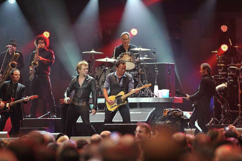 "NEW YORK, NY - DECEMBER 12:  Musicians Bruce Springsteen, Jon Bon Jovi and Max Weinberg perform at ""12-12-12"" a concert benefiting The Robin Hood Relief Fund to aid the victims of Hurricane Sandy presented by Clear Channel Media & Entertainment, The Madison Square Garden Company and The Weinstein Company at Madison Square Garden on December 12, 2012 in New York City.  (Photo by Larry Busacca/Getty Images for Clear Channel) Photo: Larry Busacca, Getty Images / Getty Images"
