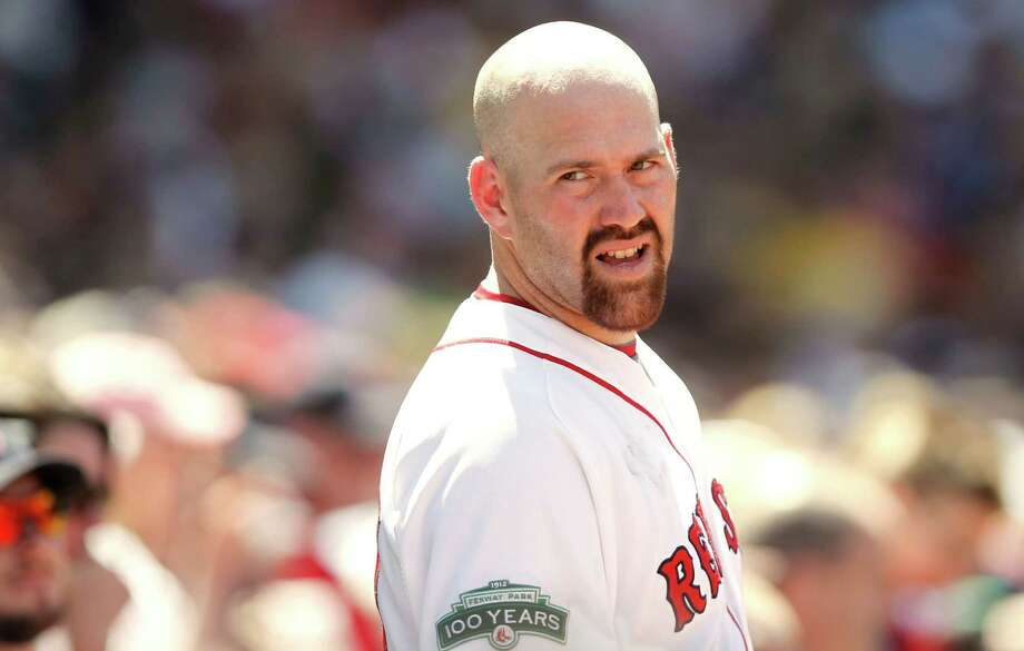 FILE - DECEMBER 11: According to reports, free agent third baseman Kevin Youkilis will sign with the New York Yankees for one year and $12 million, pending a physical.  BOSTON, MA - JUNE 24:  Kevin Youkilis #20 of the Boston Red Sox looks on from the dugout during the fourth inning of the interleague game against the Atlanta Braves at Fenway Park on June 24, 2012 in Boston, Massachusetts.  (Photo by Winslow Townson/Getty Images) Photo: Winslow Townson, Getty Images / 2012 Getty Images