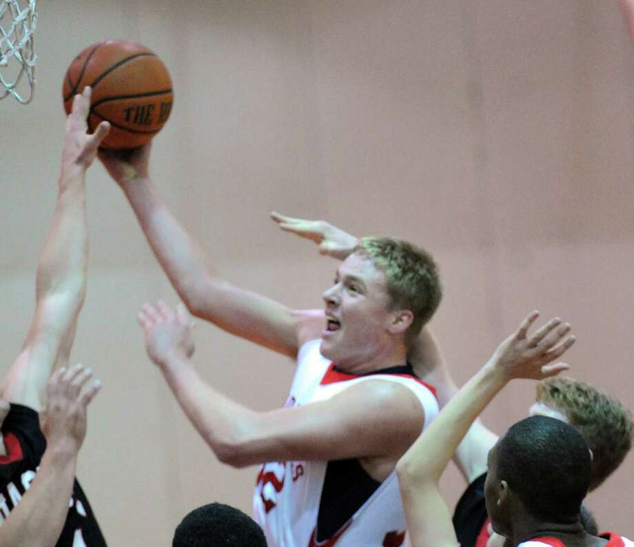 Alex Wolf of Greenwich goes in for a lay up during the boys high school basketball game between Greenwich HIgh School and Fairfield Warde High School at Greenwich High School, Wednesday night, Dec. 12, 2012. Photo: Bob Luckey / Greenwich Time