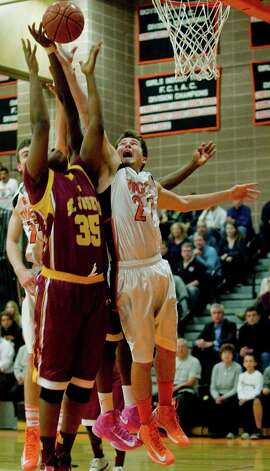 Ridgefield High School's Jon Hicks tries for the loose ball in a game against St. Joseph High School, played at Ridgefield. Wednesday, Dec. 12, 2012 Photo: Scott Mullin / The News-Times Freelance