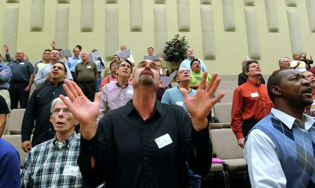 "Mark Watts, who sings tenor, joins others in the Community Bible Church choir as they rehearse for the upcoming Christmas pageant, called ""Love Came Down,"" which will be performed on December 15-16 at the church. Photo: Billy Calzada, San Antonio Express-News / SAN ANTONIO EXPRESS-NEWS"