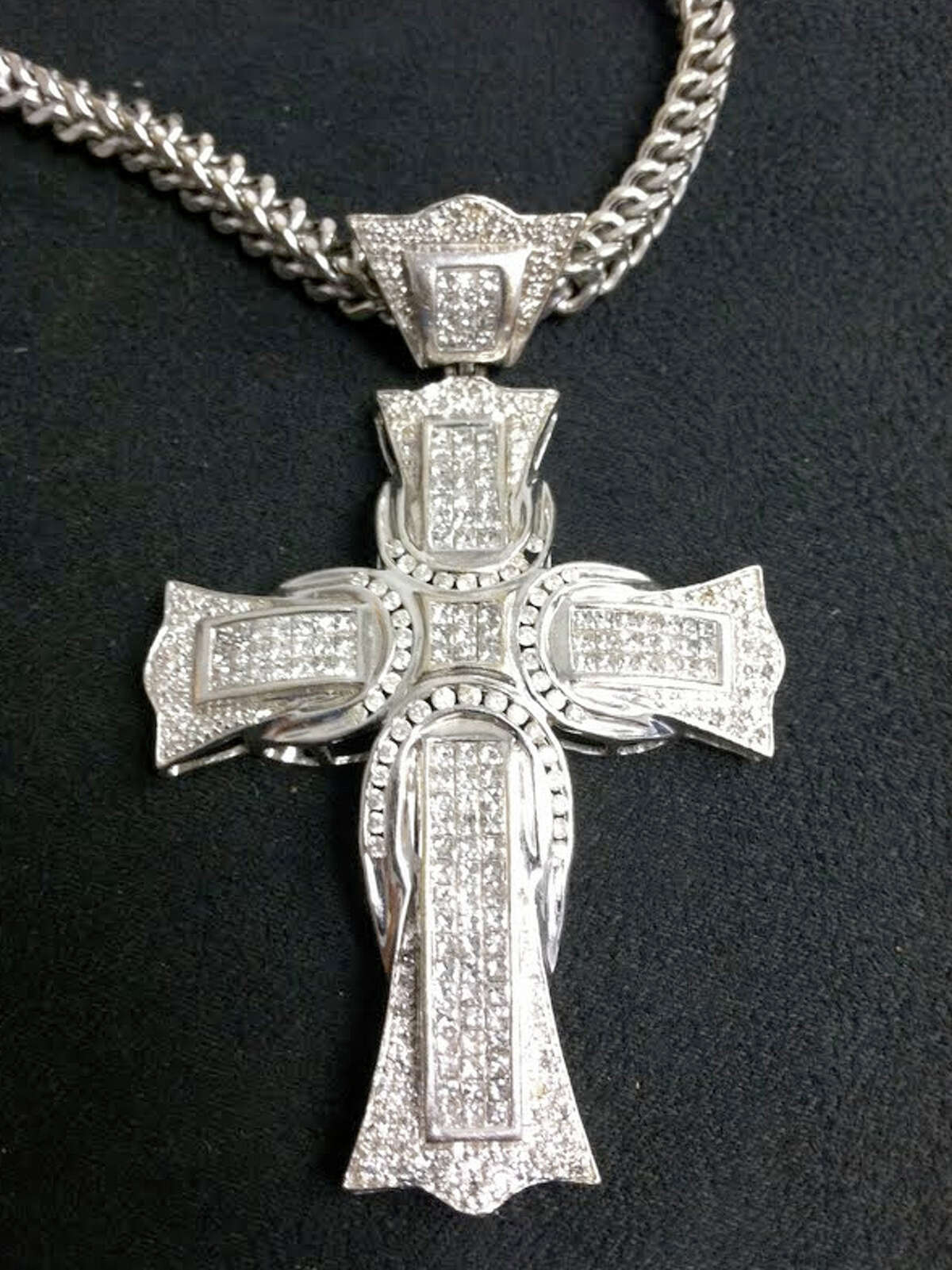 Silver-colored necklace with cross pendant