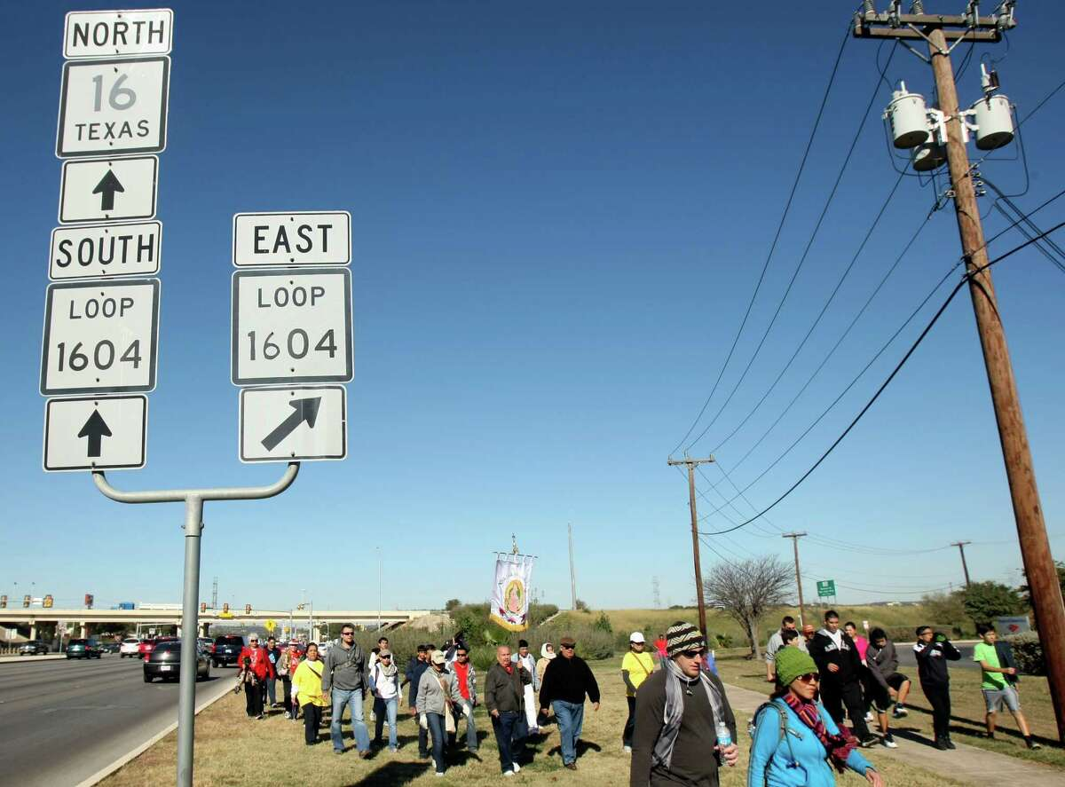 Parishioners from Our Lady of Guadalupe churches walk along Bandera Road from the church in Helotes to the parish on the city's westside as a way to mark the feast day of Our Lady of Guadalupe.