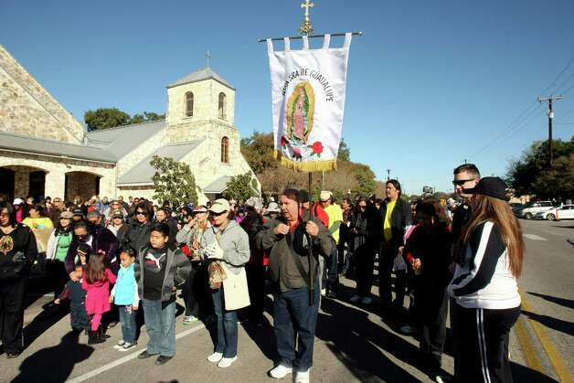 Parishioners from Our Lady of Guadalupe churches walk from the church in Helotes to the parish on the city's westside as a way to mark the feast day of Our Lady of Guadalupe. Photo: Helen L. Montoya, San Antonio Express-News / ©SAN ANTONIO EXPRESS-NEWS