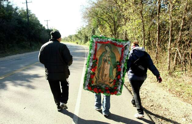 Jose Lopez, Erick Sanchez and Maggie Saucedo begin their pilgrimage as a way to mark the feast day of  the Virgin of Guadalupe. Photo: Helen L. Montoya, San Antonio Express-News / ©SAN ANTONIO EXPRESS-NEWS