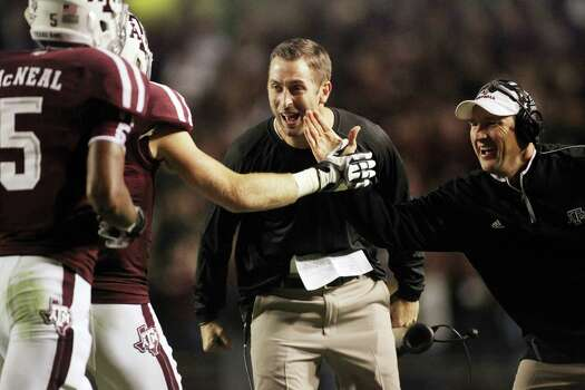 Texas A&M offensive coordinator Kliff Kingsbury celebrates after a touchdown against Missouri during an NCAA football game, Saturday, Nov. 24, 2012, in Kyle Field in College Station. Photo: Nick De La Torre, Houston Chronicle / © 2012  Houston Chronicle