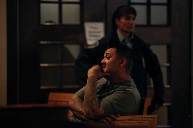 Former jailer Christopher Nieto waits for his turn on the witness stand during a hearing for Death Row inmate Noah Espada in the 399th District Court at the Cadena-Reeves Justice Center in San Antonio on Wednesday, Dec. 12, 2012. Photo: Lisa Krantz, San Antonio Express-News / © 2012 San Antonio Express-News
