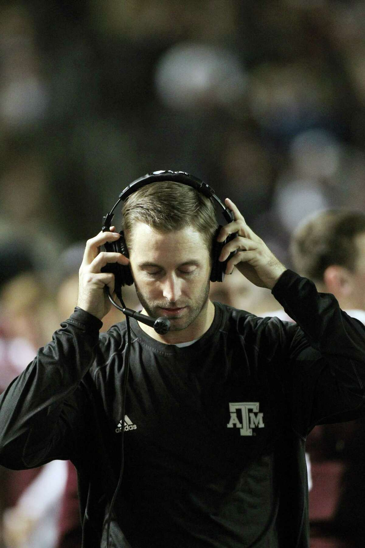 Texas A&M offensive coordinator Kliff Kingsbury adjusts his headset as he paces the sidelines against Missouri during an NCAA football game, Saturday, Nov. 24, 2012, in Kyle Field in College Station.