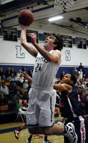 Staples' #24 Ross Whelan lays up the ball, during boys basketball action against Brien McMahon in Westport, Conn. on Wednesday December 12, 2012. Photo: Christian Abraham / Connecticut Post