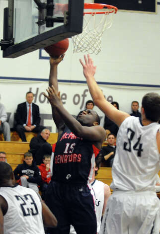 McMahon's #15 Justin Walker attempts a shot, during boys basketball action against Staples in Westport, Conn. on Wednesday December 12, 2012. Photo: Christian Abraham / Connecticut Post