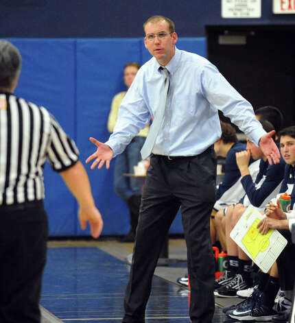 Staples Head Coach Colin Devine, during boys basketball action in Westport, Conn. on Wednesday December 12, 2012. Photo: Christian Abraham / Connecticut Post