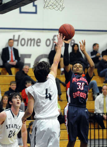 McMahon's #30 Andrew Rivera attempts a shot, during boys basketball action against Staples in Westport, Conn. on Wednesday December 12, 2012. Photo: Christian Abraham / Connecticut Post