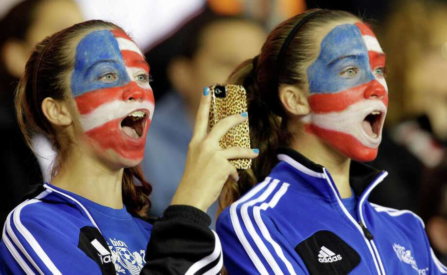 Eleven-years-old twins Emma Dyson, left, and Avery Dyson, right, cheer for the USA Women's soccer team before game against China  at BBVA Compass Stadium Sunday, Jan. 9, 2000, in Houston. Photo: Melissa Phillip, Houston Chronicle / © 2012 Houston Chronicle