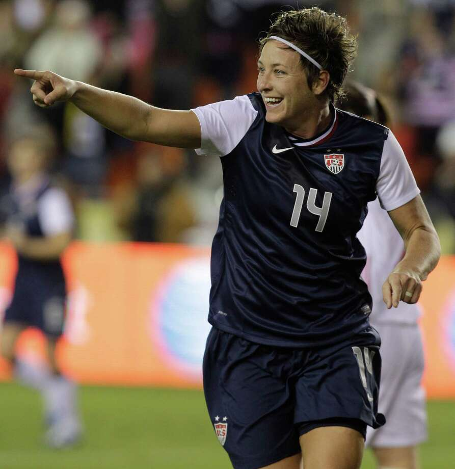 USA's Abby Wambach points after scoring goal against China to teammate Heather O'Reilly who assisted in the goal during woman's soccer game at BBVA Compass Stadium Sunday, Jan. 9, 2000, in Houston. Photo: Melissa Phillip, Houston Chronicle / © 2012 Houston Chronicle