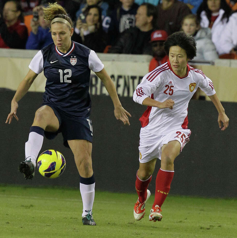 USA's Lauren Cheney, left,  controls the ball in front of China's Zhang Rui  during woman's soccer game at BBVA Compass Stadium Sunday, Jan. 9, 2000, in Houston. Photo: Melissa Phillip, Houston Chronicle / © 2012 Houston Chronicle