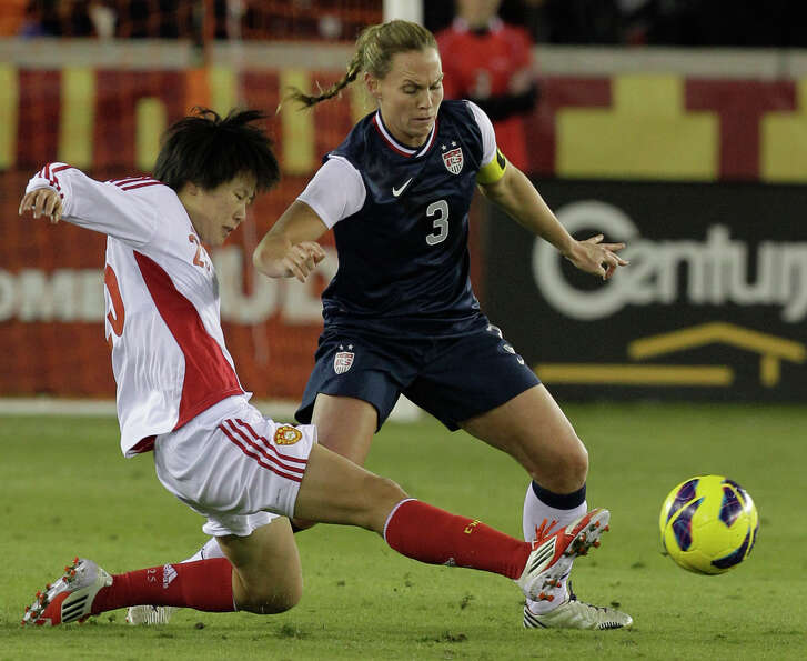 China's Zhang Rui, left, and USA's Christie Rampone battle for the ball during woman's soccer game a