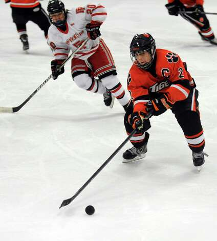 Ridgefield's Vinny Rella controls the puck during their hockey game against Fairfield Prep High School Wednesday, Dec. 12, 2012 at Wonderland of Ice in Bridgeport, Conn. Photo: Autumn Driscoll / Connecticut Post