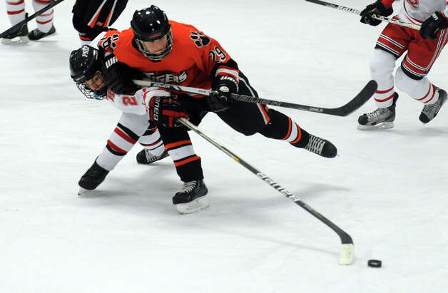 Ridgefield's Geoff Schneider controls the puck as Fairfield Prep's Tim Edmonds defends during their hockey game Wednesday, Dec. 12, 2012 at Wonderland of Ice in Bridgeport, Conn. Photo: Autumn Driscoll / Connecticut Post