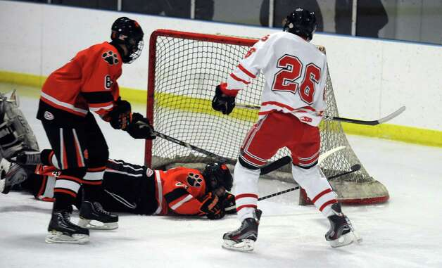 Fairfield Prep's Matt McKinney scores a goal during their hockey game against Ridgefield High School Wednesday, Dec. 12, 2012 at Wonderland of Ice in Bridgeport, Conn. Photo: Autumn Driscoll / Connecticut Post