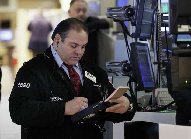 FILE - In this Tuesday, Dec. 11, 2012, file photo, trader Anthony Riccio works on the floor of the New York Stock Exchange. Expectations that the Federal Reserve will announce a new stimulus plan to help bring life to a lethargic U.S. economy boosted stock markets in Asia, where investors brushed off North Korea's latest test launch of a long-range rocket.  (AP Photo/Richard Drew, File) Photo: Richard Drew