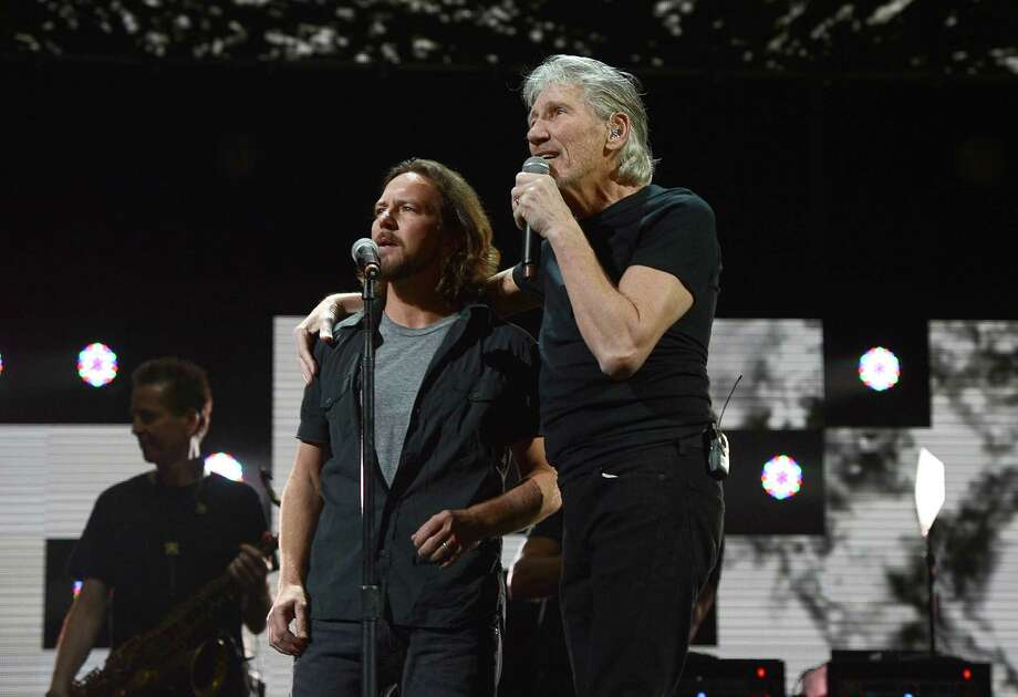 "NEW YORK, NY - DECEMBER 12:  Eddie Vedder and Roger Waters  perform at ""12-12-12"" a concert benefiting The Robin Hood Relief Fund to aid the victims of Hurricane Sandy presented by Clear Channel Media & Entertainment, The Madison Square Garden Company and The Weinstein Company at Madison Square Garden on December 12, 2012 in New York City.  (Photo by Larry Busacca/Getty Images for Clear Channel) Photo: Larry Busacca, Getty Images / Getty Images"