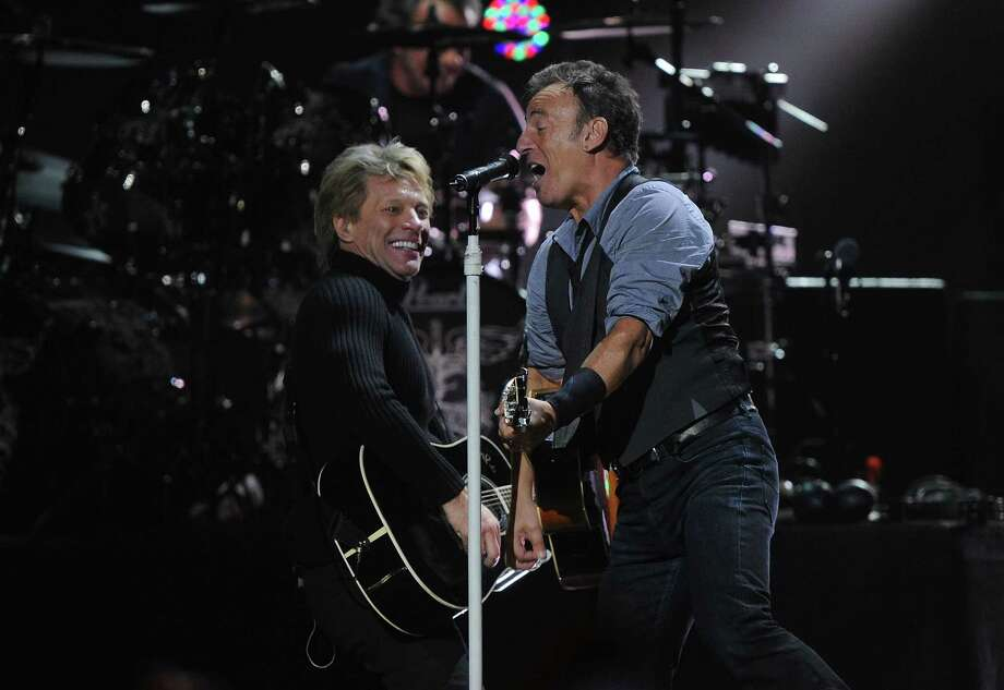 "NEW YORK, NY - DECEMBER 12:  Musicians Jon Bon Jovi (L) and Bruce Springsteen perform at ""12-12-12"" a concert benefiting The Robin Hood Relief Fund to aid the victims of Hurricane Sandy presented by Clear Channel Media & Entertainment, The Madison Square Garden Company and The Weinstein Company at Madison Square Garden on December 12, 2012 in New York City.  (Photo by Larry Busacca/Getty Images for Clear Channel) Photo: Larry Busacca, Getty Images / Getty Images"