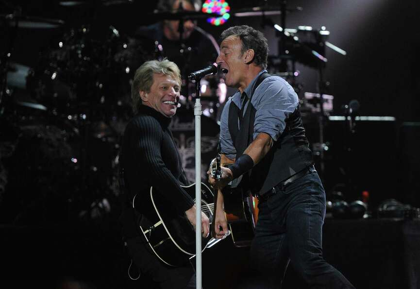 NEW YORK, NY - DECEMBER 12:  Musicians Jon Bon Jovi (L) and Bruce Springsteen perform at