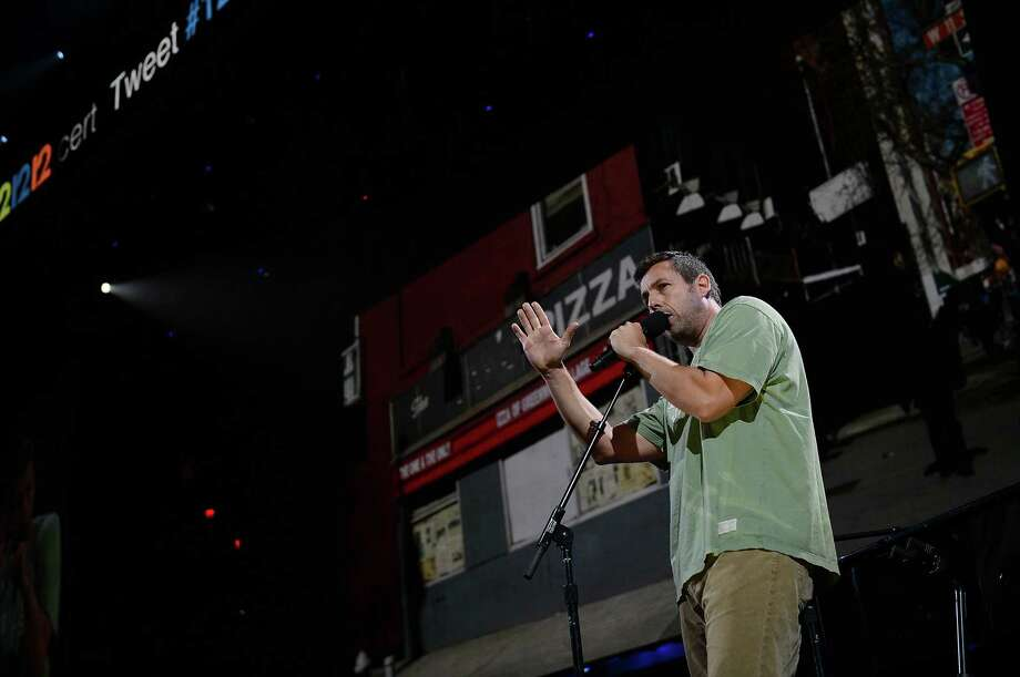 "NEW YORK, NY - DECEMBER 12:  Adam Sandler performs at ""12-12-12"" a concert benefiting The Robin Hood Relief Fund to aid the victims of Hurricane Sandy presented by Clear Channel Media & Entertainment, The Madison Square Garden Company and The Weinstein Company at Madison Square Garden on December 12, 2012 in New York City.  (Photo by Larry Busacca/Getty Images for Clear Channel) Photo: Larry Busacca, Getty Images / Getty Images"