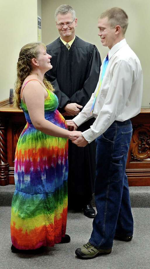 Danille Leavens and Charles Reid of Eau Claire were married at the Eau Claire County Courthouse by Court Commissioner Nathan Novak in Eau Claire, Wis., on Wednesday, Dec. 12, 2012. The couple chose the memorable date because of its uniqueness and jokingly said for its ease to remember. Photo: Dan Reiland, Associated Press / Eau Claire Leader-Telegram