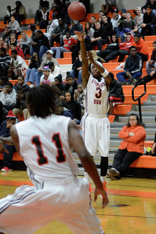 Stamford #3 Evans Antoine goes for three as Stamford High School hosts Bassick High School in boys varsity basketball in Stamford, CT on Dec. 12, 2012. Photo: Shelley Cryan / Shelley Cryan for the Stamford Advocate/ freelance Shelley Cryan