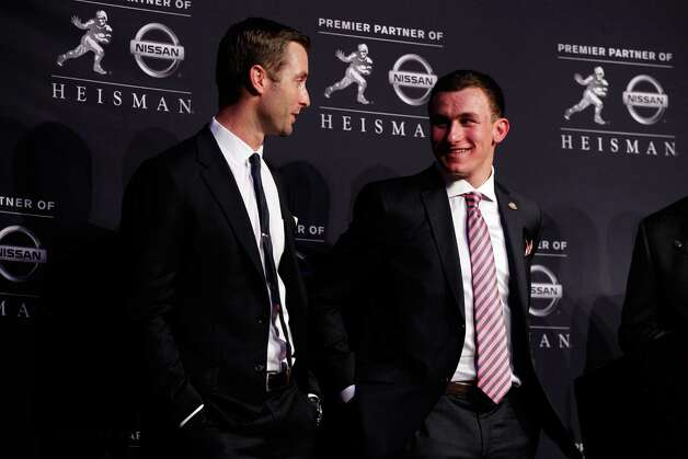 Kliff Kingsbury (left) is no longer at Johnny Manziel's side like he was Saturday. Photo: Mike Stobe, Getty Images / 2012 Getty Images