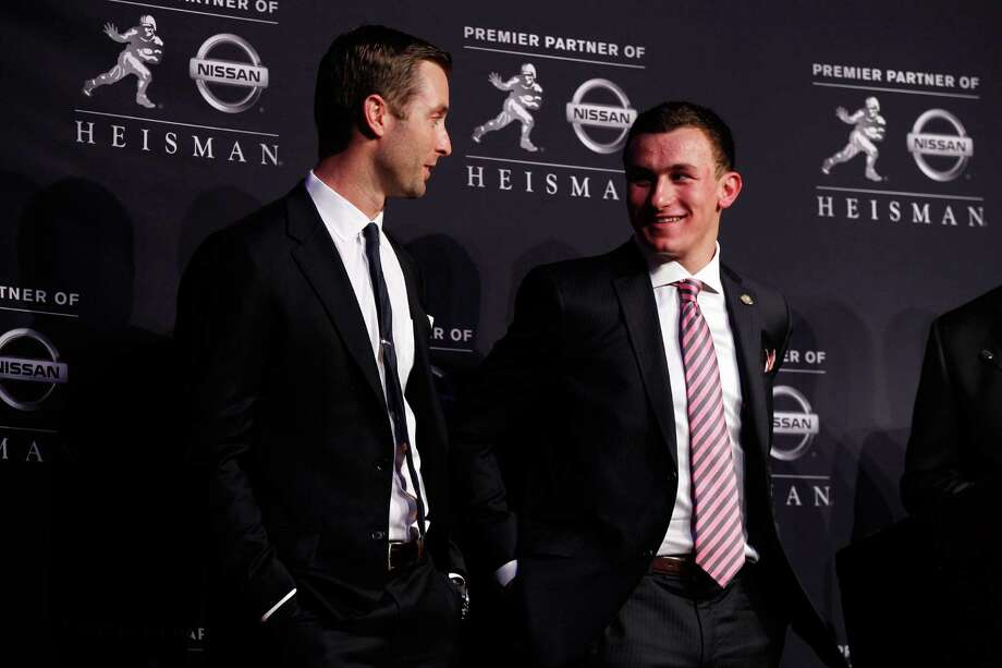 NEW YORK, NY - DECEMBER 08:  (L-R) Offensive Coordinator/Quarterbacks Kliff Kingsbury quarterback Johnny Manziel of the Texas A&M University Aggies pose after being named the 78th Heisman Memorial Trophy Award winner at a press conference at the Marriott Marquis on December 8, 2012 in New York City. Photo: Mike Stobe, Getty Images / 2012 Getty Images