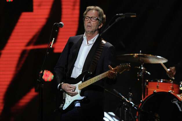 "NEW YORK, NY - DECEMBER 12:  Eric Clapton performs at ""12-12-12"" a concert benefiting The Robin Hood Relief Fund to aid the victims of Hurricane Sandy presented by Clear Channel Media & Entertainment, The Madison Square Garden Company and The Weinstein Company at Madison Square Garden on December 12, 2012 in New York City.  (Photo by Larry Busacca/Getty Images for Clear Channel) Photo: Larry Busacca, Getty Images / Getty Images"