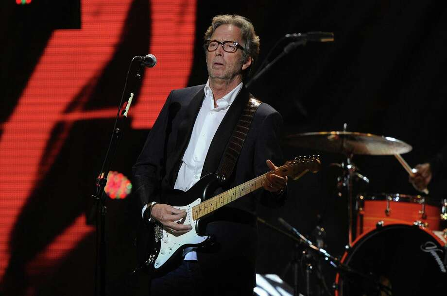 """NEW YORK, NY - DECEMBER 12:  Eric Clapton performs at """"12-12-12"""" a concert benefiting The Robin Hood Relief Fund to aid the victims of Hurricane Sandy presented by Clear Channel Media & Entertainment, The Madison Square Garden Company and The Weinstein Company at Madison Square Garden on December 12, 2012 in New York City.  (Photo by Larry Busacca/Getty Images for Clear Channel) Photo: Larry Busacca, Getty Images / Getty Images"""
