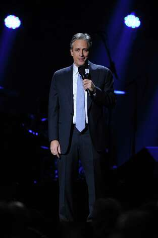 "NEW YORK, NY - DECEMBER 12: Jon Stewart performs at ""12-12-12"" a concert benefiting The Robin Hood Relief Fund to aid the victims of Hurricane Sandy presented by Clear Channel Media & Entertainment, The Madison Square Garden Company and The Weinstein Company at Madison Square Garden on December 12, 2012 in New York City.  (Photo by Larry Busacca/Getty Images for Clear Channel) Photo: Larry Busacca, Getty Images / Getty Images"