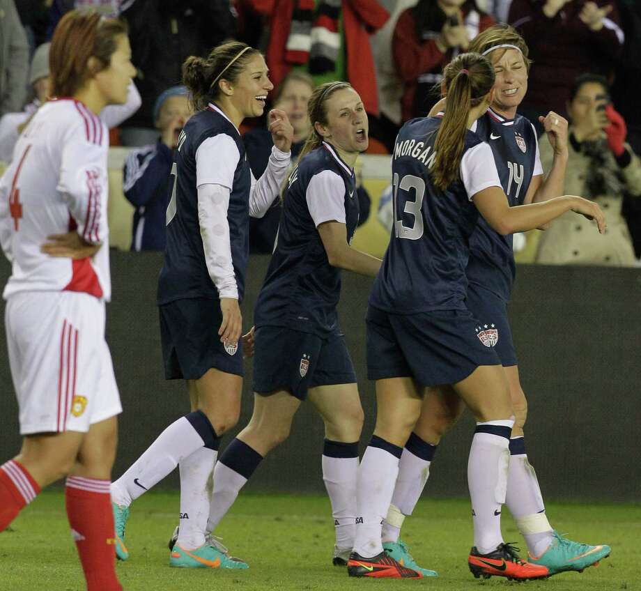 USA's (14) Abby Wambach celebrates with teammates after goal against China in the second half of woman's soccer game at BBVA Compass Stadium Sunday, Jan. 9, 2000, in Houston. The goal was her 150th international goal. Photo: Melissa Phillip, Houston Chronicle / © 2012 Houston Chronicle
